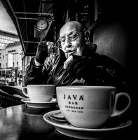 Street Photography by Alf Myers - a man takes a sip of coffee from his spoon